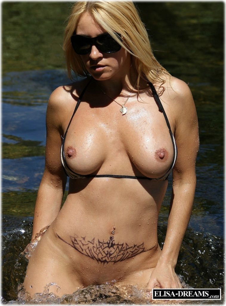 Sexy howife posing in the river