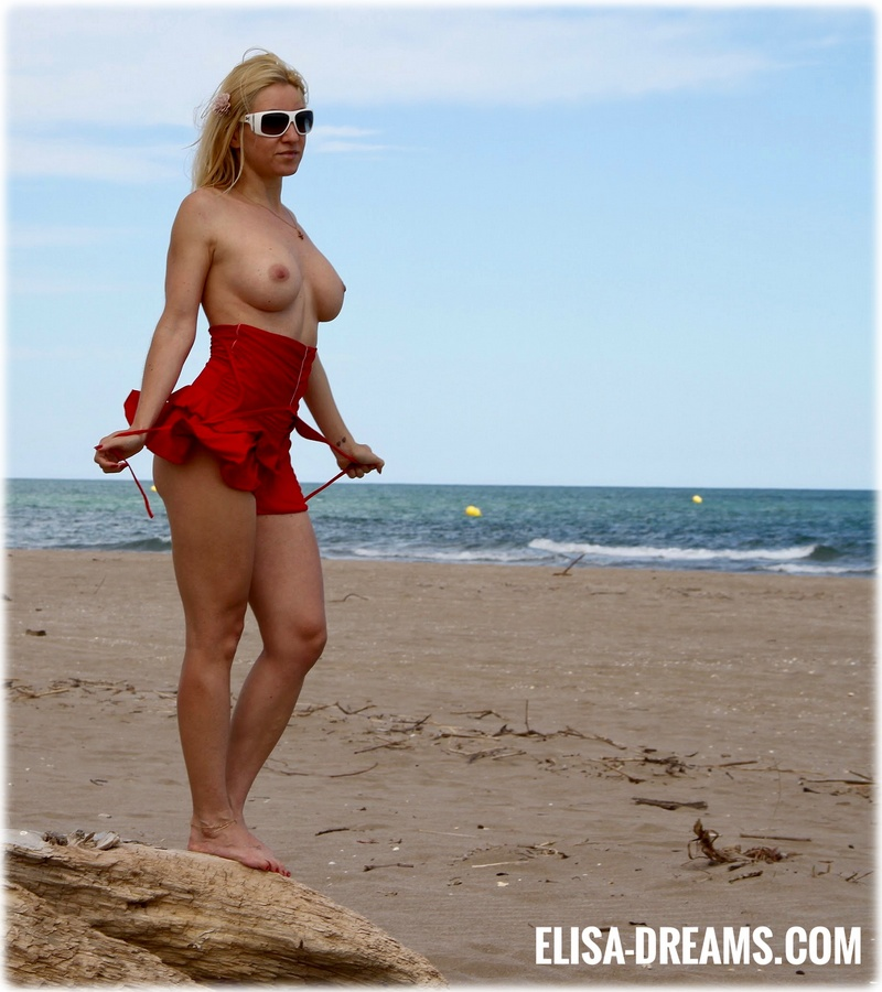 Sexy hotwife posing at the beach